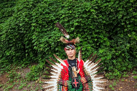 A young Cherokee dancer before the Spirit of Nations Powwow in Knoxville, Tennessee. August 9, 2014.