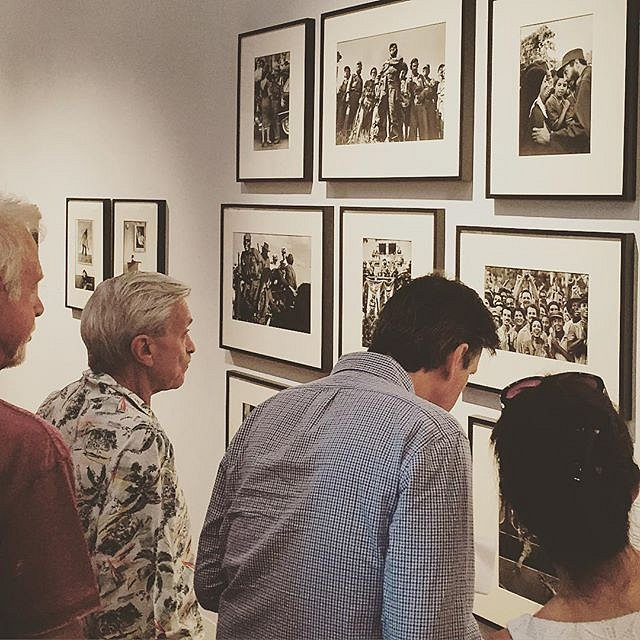 The crowd checking out Burt Glinn's photos of the Cuban Revolution.