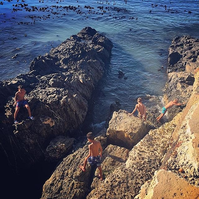 Boys. #seapoint #capetown #southafrica #seapointpromenade #boys #climbingrocks #summer #holiday
