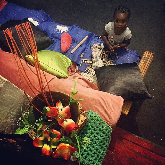 Zippoorah Lottering, almost two years old, at play in the living room. #lovefrommanenberg #manenberg #capetown #capeflats #southafrica #africa #personalwork #flowers #clothespins #atplay