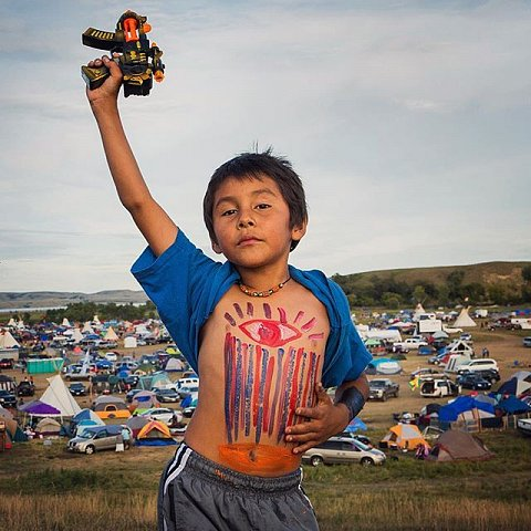 A young man plays in the Oceti Sakowin Camp near Cannon Ball, N.D. on September 10, 2016. Thousands of protesters have gathered in the camp to join the Standing Rock Sioux Tribe in their fight against the construction of the Dakota Access Pipeline. If built, the pipeline will be laid under the Missouri River, located on the edges of the Standing Rock Sioux Reservation. The pipeline threatens the availability of clean water and disrupts sacred sites and burial grounds. #editing #northdakota #NoDAPL #standingrocksioux