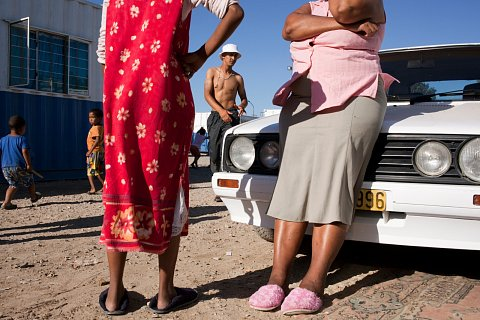 """I didn't raise my child to be a gangster, but as a mother I must live with it and see what the end of the day will bring,"" says Charmaine Pietersen, right. Charmaine's son, Ashwin, center, is a member of the Hard Livings gang, one of the oldest, largest, and most powerful gangs in Manenberg.  <br> Manenberg, March 2014."