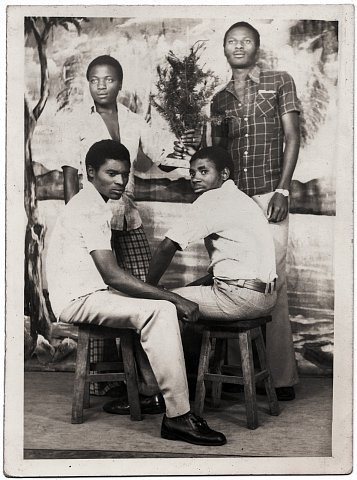 Barthélemi, Pere Déo and two friends. From a Katembera family photo album. Studio Lubwe, Goma, D.R.C., January 25, 1977.