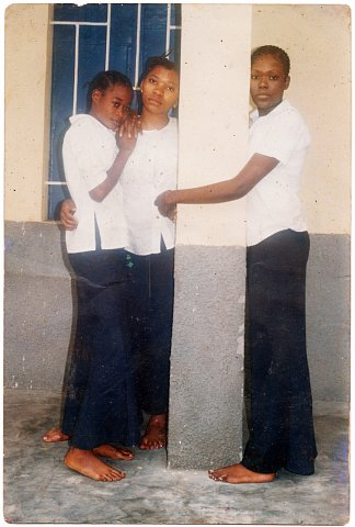 Biwa Muya and friends. From a Muya family photo album. Photographer unknown. Kinshasa, D.R.C., c. 2005