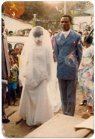 Emmanuel Nshindi and Nicole Nshindi on their wedding day. From a Nshindi family photo album. Photographer unknown. Kinshasa, D.R.C., c. 1975.