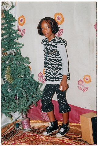 From a Nshindi family photo album. Photographer unknown. Kinshasa, D.R.C., c. 2010.
