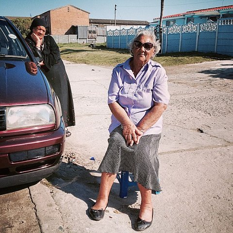 Ester Petersen, 75 years old, has been in Manenberg 45 years. SS: What does Manenberg mean to you? EP: Manenberg was very quiet until the gangsters. My children grew up here. My son is a pastor. SS: How have the gangs impacted your life? EP: I just pray for them, that is all. The Lord will sort everything. #southafrica #africa #capetown #manenberg #lovefrommanenberg #gangs