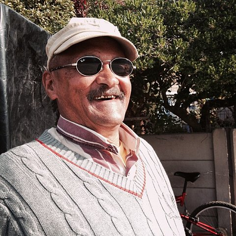 Faizel Saville, 67 years old, has lived in Manenberg 42 years. SS: What does Manenberg mean to you? FS: I've seen a lot of things. It's the people who are changing it. Now it's gangsters and crime. SS: How have the gangs impacted your life? FS: They haven't really impacted me because I haven't been involved. My children aren't involved. I traveled the world working on cargo ships for 19 years. Before that I worked in the diamond mines. #southafrica #africa #capetown #manenberg #father #lovefrommanenberg