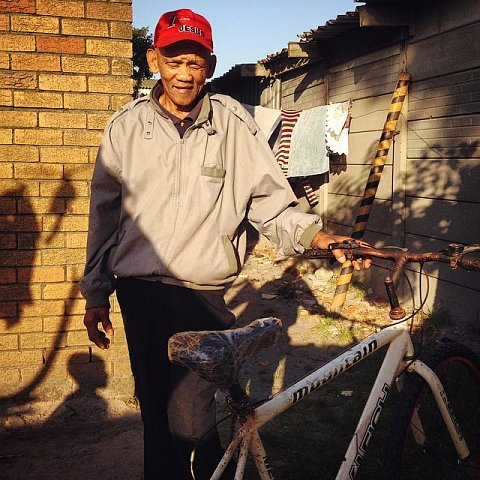 Franz Lottering, 69 years old. Franz rides his bike across Manenberg to his daughter Debby's house every day. He's a devoted father and grandfather, a role model for his family, to say the least. #southafrica #africa #capetown #manenberg #family #father #grandfather #lovefrommanenberg