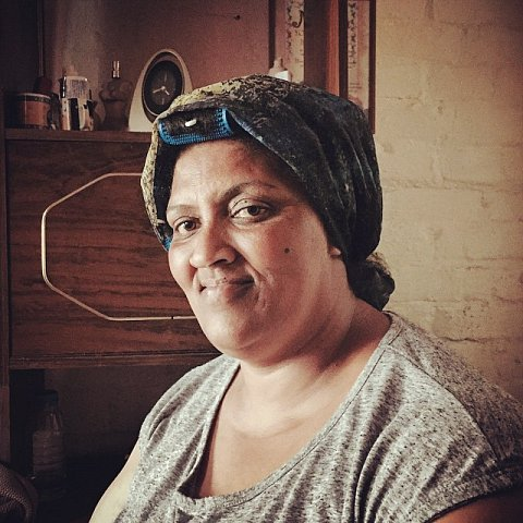 Queenie Duplessis. SS: What does Manenberg mean to you? QD: I wasn't born here but I was 14 when we came to stay. My children were born in Manenberg. For the sake of my father, who is still alive and living with me, I would rather stay in Manenberg than move somewhere else. SS: How have the gangs impacted your life? QD: I am very nervous because 2 years ago when I was sick and couldn't walk, they shot the guy who stayed behind us. I thought they were shooting at me. The fear made me so sick that I was hospitalized for a month. #capetown #southafrica #africa #manenberg #lovefrommanenberg