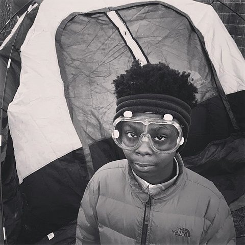 Quantmea Dillon,13, from North Minneapolis wears goggles to protect his eyes from the smoke in the air from fires lit by protesters to stay warm. #blacklivesmatter #jamarclark #protest #minnesota #minneapolis #releasethetapes