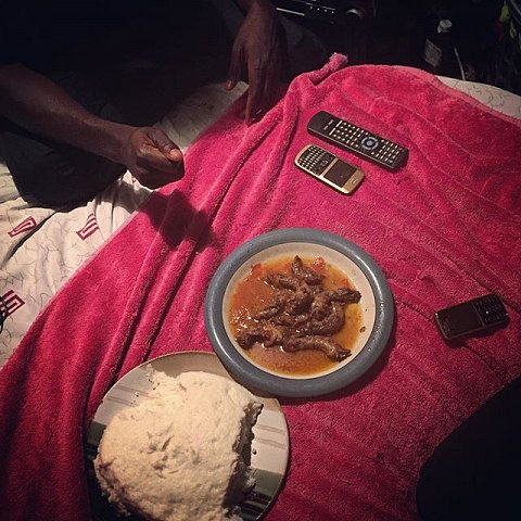 Brothers from Malawi living in South Africa share plates of nsima (maize flour and water) and chicken necks for New Year's Eve dinner. Malawians are the most dispersed group in Southern Africa. #2016 #happynewyear #capetown #capeflats #southafrica #immigration #nsima #malawi #thambovillage #manenberg #gugulethu