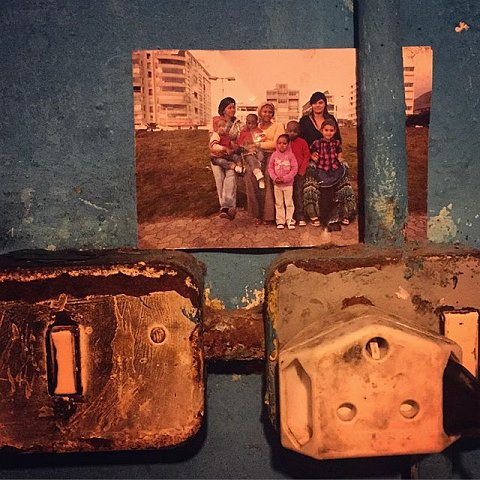 There are few things that make me happier as a photographer than to see the pictures I've left behind stored and displayed alongside other family photographs. This picture, hanging in Debby Lottering's home in Manenberg, South Africa, was taken in 2012 at the Sea Point Promenade. It pictures sisters Naomi and Debby Lottering with their children Shaquille, Zobie, and Meezie, and neighbor Chantel Pietersen with her daughter, Chandre. #lovefrommanenberg #family #capeflats #capetown #seapoint #archives #familyalbums #powerofphotography #manenberg