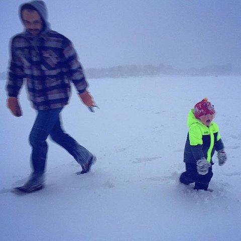 #family #fatherandson #snowstorm #minnesota #midwest #usa #winter #lakeminnetonka #frozen