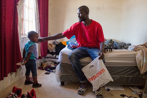 One-year-old Zipporah Lottering visits her father, Kazuba, who lives in Philippi, a suburb four miles from Manenberg. Kazuba sees his daughter an average of once every two months. <br> Philippi, January 2016.