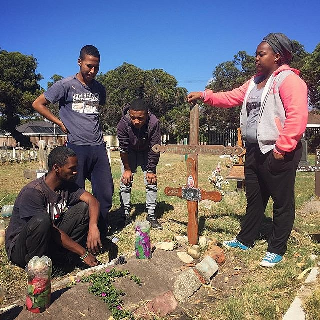 Friends of Ashwin Pietersen, who was murdered in Manenberg, visit his grave. #gailcourt #manenberg #capetown #southafrica #lovefrommanenberg