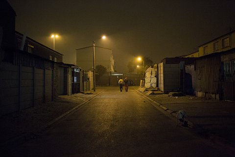 Two men walk through the streets of Manenberg.<br> Manenberg, April 2016.