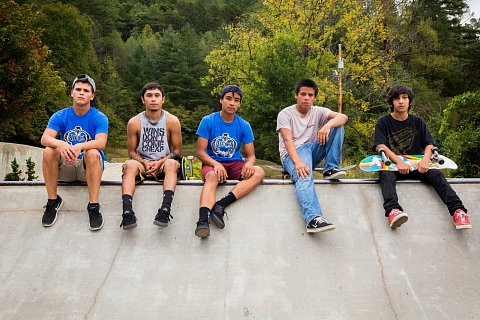 Young men at the skatepark. Pictured from left to right are Ryan Tranter, 19, Michael George, 18, Xavier Locust, 17, Terrance Crowe, 16, and Leonardo Davis, 13. All are EBCI tribal members and in different stages of school from college to middle school.<br>Qualla Boundary, October 2016.