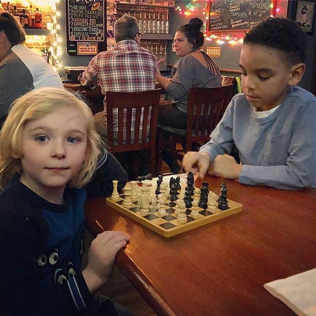 Erudites Errol and Kai play chess while their mama's watch college basketball #chess #newyork #brooklyn #basketball #goduke #friendshipismagic #showoffs #whatsamomtodo