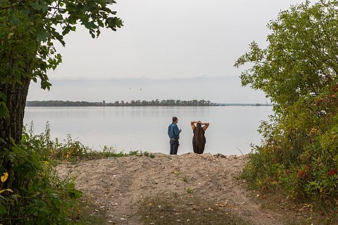 "Lucas and Veronica Bratvold stand at the edge of Red Lake at a place called ""Obaashiing,"" or ""where the wind blows."" The Bratvolds are Ojibwe and members of Red Lake Nation. Mrs. Bratvold works with the Supplemental Nutrition Assistance Program (SNAP) on the Red Lake Indian reservation in northern Minnesota. She educates the community about nutrition through an indigenous lens, empasizing the importance of knowing where their food comes from. Mr. Bratvold teaches Anishinaabe and U.S history and the Ojibwe language at Red Lake Nation College. <br>September 2017."