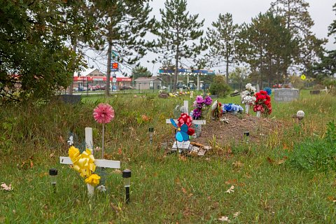 A cememetery on the Red Lake Indian Reservation in northern Minnesota. Red Lake has a high incidence of heroin and opiate related deaths as well as diabetes and heart disease. <br>September 2017.