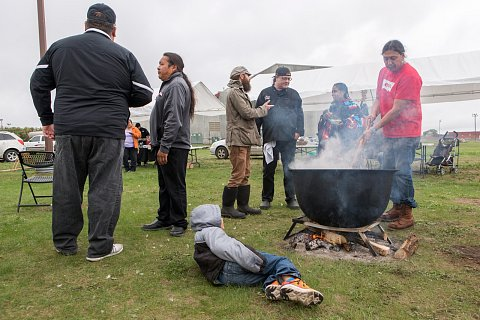 Participants of the second annual Red Lake Nation Food Summit gather around a pot of hominy and moose meat. <br>September 2017.