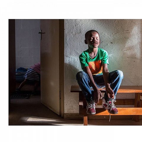 I've been working in Manenberg since 2011, looking at the ways a community plagued by gang violence –– stemming from historical, geographical, cultural, and governmental oppression –– looks to the future and manages the loves, losses and predictabilities of day-to-day living. Pictured is Meezie Lottering at 7 years old in 2017 (1st and 3rd image) and at 3 years old. A boy on the precipice of becoming a young man, he's faced with putting together the pieces of his masculinity. Raised by a single mother, he looks to her, his older brother, and his community for guidance. As the parent of a nearly 6-year-old boy I'm familiar with the ways society sends entrenched and harmful messages to youth about what it means to be a man. The daily work of diffusing these messages is something Meezie's mother and I have often discussed. Though we're raising our sons in very different circumstances, the shared uncertainty of a child's future is a poignant and weighty experience for us both.