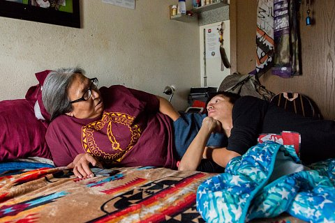 Antoinette Goodlow, who goes by Toni, and her son, Danny Grassrope, inside Goodlow's bedroom.<br>Lower Brule, South Dakota, November 2017.