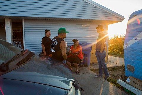 Joseph White Eyes, right, with his family. <br>Cheyenne River, South Dakota, August 2018.