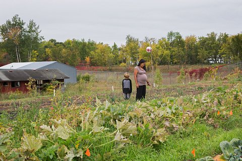 Regina Rushman stands with her son, Forest, in the community garden on the Red Lake Indian Reservation. <br>September 2017.