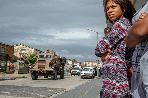 The South African National Defense Force (SANDF) and South African Police Service (SAPS) patrol the streets. Soldiers and police officers were deployed to Manenberg in September 2019 after  an exceptionally bloody surge in gang violence. <br>Manenberg, December 2019.