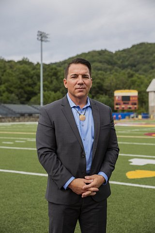 EBCI Principal Chief Richard G. Sneed stands on the athletic field at Cherokee Central Schools. He taught vocational education there and worked as a pastor before running for office. He is working to create a Cherokee cultural corridor to preserve and protect historic sites. <br>Qualla Boundary, September 2020.