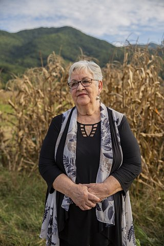 Former EBCI Principal Chief Joyce Dugan stands at Kituwah, the sacred site she helped to buy in 1996, marking the tribe's first major land purchase in over a century. Dugan is the first—and only—woman to be elected as Principal Chief. <br> September 2020.