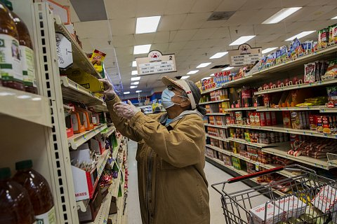 Joyce Edwards is required to wear a mask and gloves while shopping inside the Lakota Thrifty Mart in Eagle Butte. In contrast to Republican governor Kristi Noem's approach to the pandemic, the leadership of the Cheyenne River Reservation, a sovereign Lakota nation, have taken a vigilant approach to the pandemic. October 23, 2020.