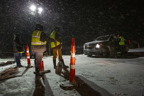 """Motorist checkpoints on roads with access to the Cheyenne River Reservation in South Dakota operate 24 hours per day. To help prevent the spread of Covid-19, only residents, essential workers, and commercial vehicles are allowed to enter the reservation.Staffing the checkpoints was hard work. South Dakota's winters are brutal, and some drivers were angry that they couldn't access the reservation. Still, hundreds of tribal members stepped forward to be deputized as special health and safety officers. Remi Bald Eagle, the intergovernmental affairs coordinator for the tribe, told me, """"We have to do what we can with what we have. And what we have is strong, resilient and beautifully humorous people who are willing to lay down their lives and stand on our borders...and do the work necessary to help keep this virus from spreading."""" October 24, 2020."""