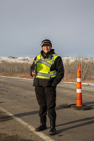 """Shantoya Bruguier is the shift leader at the Cheyenne River Bridge checkpoint on Highway 63, located on the southern border of the Cheyenne River Reservation. Bruguier has been a member of the Cheyenne River Covid security team since April. """"We can do this for our people, so this is what we're gonna do,"""" says Bruguier of the checkpoints. """"We gotta do what we gotta do to protect our people."""" Against the tribe's rights as a sovereign Lakota nation, South Dakota Governor Kristi Noem ordered the tribe to remove the barriers, a demand it has rejected. October 23, 2020."""