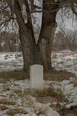 The grave of Etokeah, known as Chief Hump, a Minηicoηjou Lakota and revered leader, in Cherry Creek. Hump, a comrade of Crazy Horse and Red Cloud, refused to sign the Treaty of Fort Laramie in 1866 and in 1876 led men into battle against Generals George Crook and George Custer. After the Wounded Knee Massacre in 1890, Hump and several other Lakota leaders traveled to Washington, D.C., asking for fair treatment of their people. He died in Cherry Creek in 1908.  October 29, 2020.