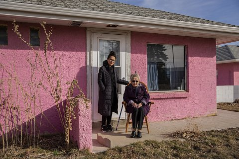 """Marcella LeBeau with her granddaughter, Dawnee LeBeau. Marcella, 101, is the oldest matriarch on the Cheyenne River Reservation. Marcella and Dawnee are both fully vaccinated. """"I do the best I can for myself and for my people,"""" said Marcella who was a nurse for over 30 years. The day this photo was made was the second time Dawnee and Marcella were able to spend time together since the pandemic began. """"It's part of our way to check in on each other a lot and that changed extremely,"""" Dawnee told me. When Marcella was born in 1919 she wasn't considered a citizen of the United States. Her great-grandfather fought in the Battle of the Little Bighorn. The fight was an overwhelming victory for the Lakota. March 9, 2021."""